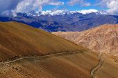 foto of jammu kashmir  - Rocky landscape of with ice peaks and blue sky in background Ladakh Jammu and Kashmir India - JPG