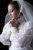 A old bride in a studio black background