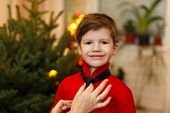 Mom Binds Tie For Little Boy At Christmas