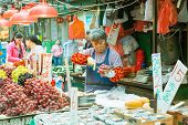 Fruit seller in the street market