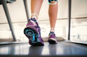 foto of treadmill  - Woman walking on the treadmill against fitness interface - JPG