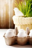 image of grass bird  - Vertical Easter background with eggs in the box and cute bird in green grass at the back - JPG