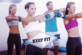 The word keep fit and class exercising with dumbbells in gym against badge
