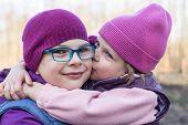 Sister Lovingly Kissing Her Older Sister