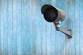 CCTV camera against wooden planks