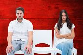 stock photo of not talking  - Angry couple not talking after argument against red wooden planks - JPG