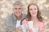Casual couple having coffee together against light glowing dots design pattern