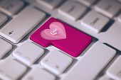 Love heart against pink enter key on keyboard