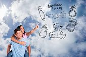 Young man giving girlfriend a piggyback ride against bright blue sky with clouds