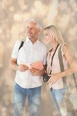 Happy tourist couple using the guidebook against light glowing dots design pattern