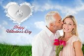 Affectionate man kissing his wife on the cheek with roses against cloud heart