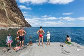 People Are Swimming In The Atlantic Ocean Along The Coast Of Madeira, Portugal