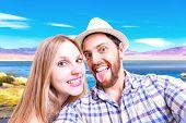 Beautiful Couple taking a selfie photo in Atacama, Chile