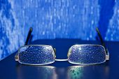 Spectacles Of Water Droplets On The Glasses