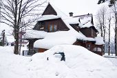 House And Car Under Snow In The Mountain Village Polish