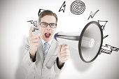 Geeky businessman shouting through megaphone against white background with vignette