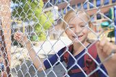 stock photo of playground school  - A smiling little girl at school playground - JPG