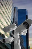 CCTV camera against low angle view of skyscrapers