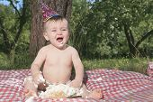 Baby girl celebrating her first bithday with gourmet cake