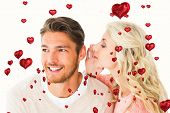 Attractive blonde whispering secret to boyfriend against red heart balloons floating