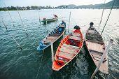 Small fishing boats dock at the shore