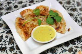 picture of doughy  - A delicious Malaysian cuisine served with curry - JPG