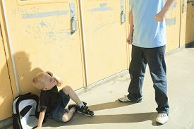 foto of school bullying  - A boy bullying another in school playground - JPG