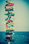 image of directional  - Funny direction signpost with distance to many different countries - JPG