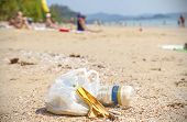 stock photo of environmental pollution  - Garbage on a beach environmental pollution concept picture - JPG
