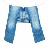 image of peg-leg  - Blue Jeans On Washing Line Isolated On White - JPG