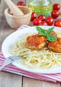 stock photo of meatball  - Meatballs in tomato sauce with spaghetti on a white plate - JPG