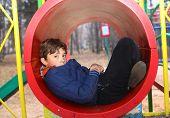 picture of preteen  - preteen handsome boy on the slide playground - JPG