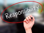 pic of responsible  - Man hand writing Responsibility on visual screen - JPG