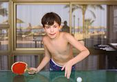 image of preteens  - preteen handsome boy play table tennis in the beach recreation area - JPG