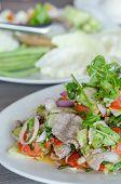 foto of thai cuisine  - Spicy salad of roasted beef Thai style cuisine - JPG