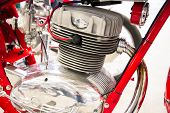 stock photo of carburetor  - detail of the head of the engine of a red vintage motorcycles - JPG