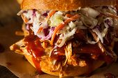 stock photo of pulling  - Homemade Pulled Chicken Sandwich with Coleslaw and Fries - JPG