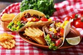 foto of potato chips  - Homemade beef burritos with vegetables - JPG