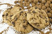 stock photo of chocolate-chip  - Chocolate chip cookies on white background with chocolate balls - JPG