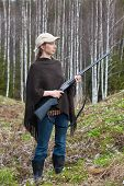 image of hunter  - Woman hunter with gun in spring forest - JPG