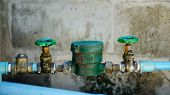 foto of waterspout  - water pipe and meter with waterspout  - JPG