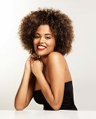 stock photo of afro hair  - happy smiling black woman with an afro hair - JPG