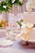 image of champagne glasses  - Picture of a Two Champagne Glasses and Wedding cake - JPG
