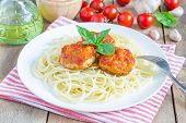 pic of meatball  - Meatballs in tomato sauce with spaghetti on a white plate - JPG