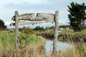 foto of marshes  - Very old wooden sign in the marshes - JPG