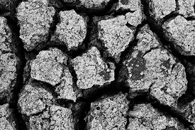 stock photo of water shortage  - Dried soil caused by shortage of water in summer season - JPG