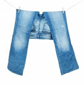 pic of peg-leg  - Blue Jeans On Washing Line Isolated On White - JPG