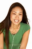 Laughing Asian Woman With Ear Buds