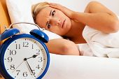 Clock with sleepless at night. Woman can not sc