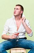 Handsome Man Sitting With Glass Of Alcohol. Caucasian Gay